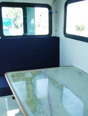 Dinette table with chart of Channel Islands