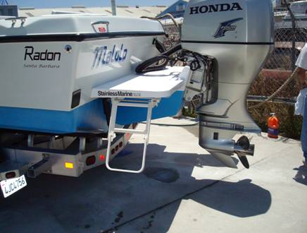The Stainless Marine outboard bracket doubles as a swim step