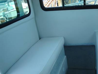 Side passenger seat with storage below