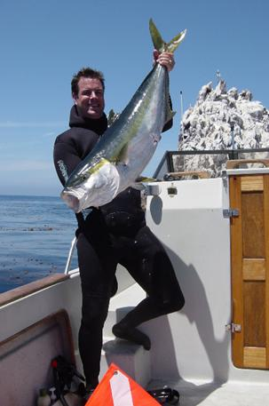 John Grant holding a 36 pound yellowtail