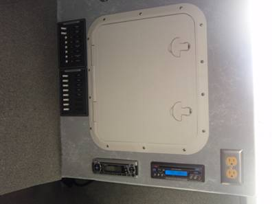 Electrical access hatch with stereo and AC outlet