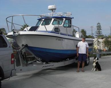 Tony Hotchkiss with his boat and his dog, Oso