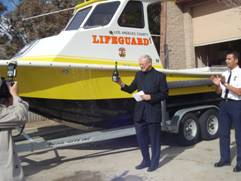 Mike Antonovich and Hugo Maldonado christen the new boat