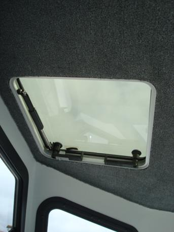 Ventilation hatches above helm and passenger seats