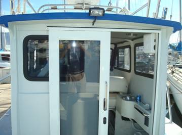 Rear sliding door and mini galley to the right