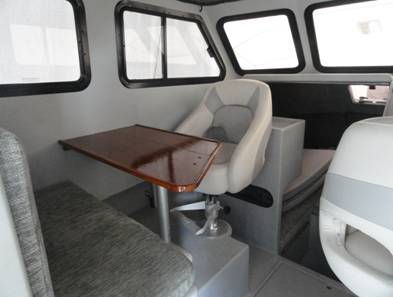 Passenger side helm seat facing the dinette table