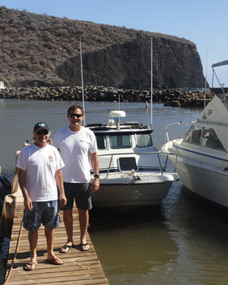 Don and Bill Parsons in front of Bill's 24' Radon in the Lanai harbor