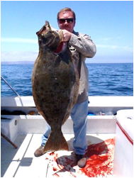Jeremy with his 47 pound halibut!!!!!!!!
